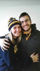 Young marketing professional, Shannon, and her boyfriend tailgating at a WVU football game near Milan Puskar stadium.